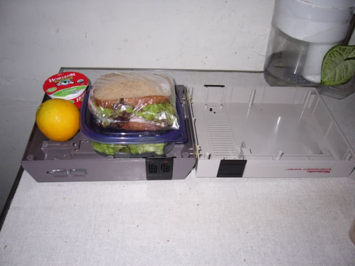 A Nintendo console is used as a lunchbox