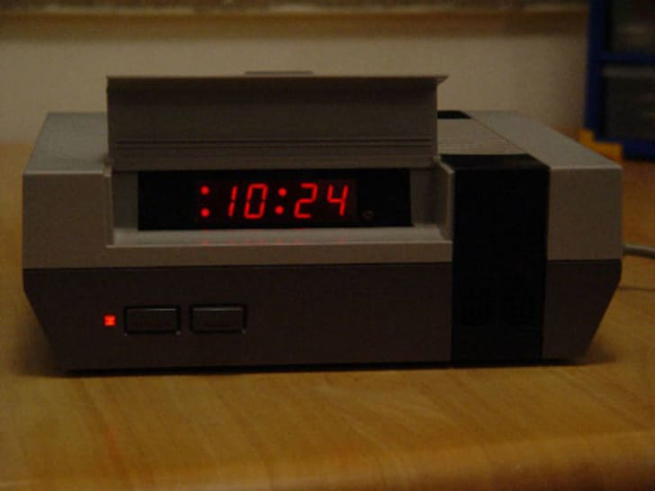 A Nintendo console is shown after being modified into an alarm clock