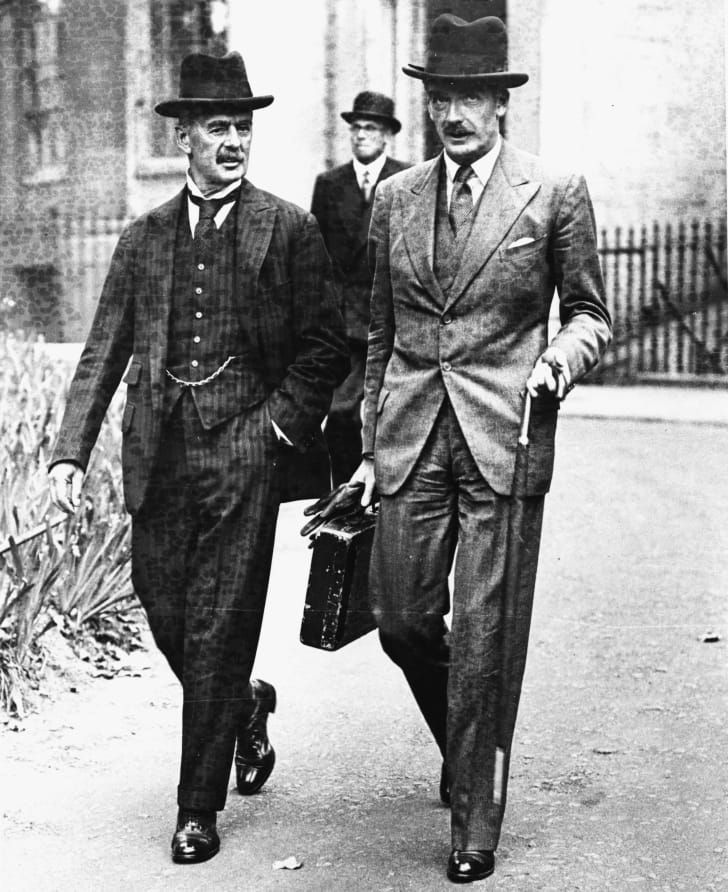 British Foreign Secretary Sir Anthony Eden (right) with Neville Chamberlain, Leader of the Conservative Party, wearing Homburg hats while walking in London in 1937.