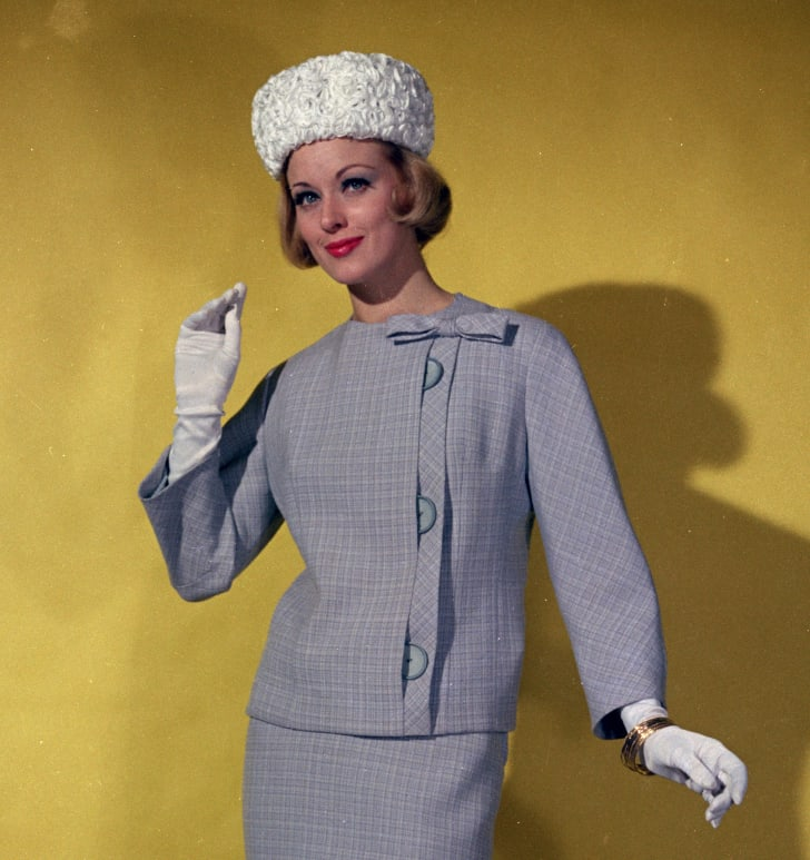 Woman wearing a pillbox hat in the 1960s.