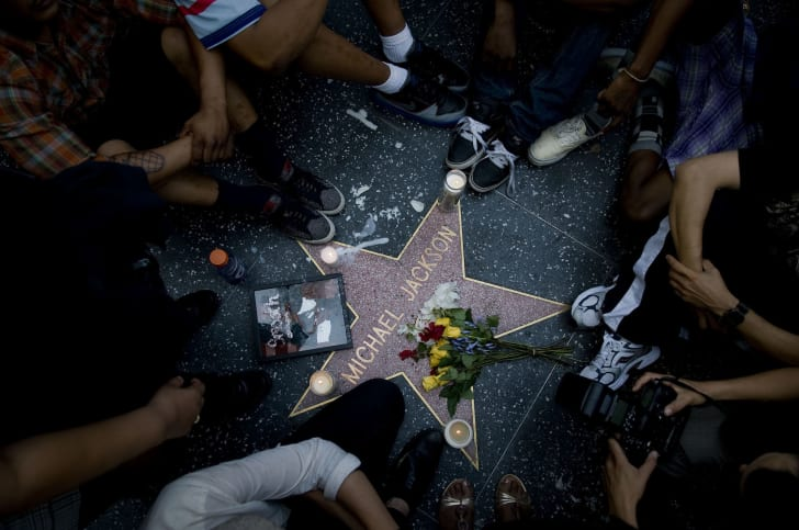 Fans of pop star Michael Jackson mourn his death at talk radio host Michael Jackson's star on the Hollywood Walk of Fame on June 25, 2009 in Los Angeles, California