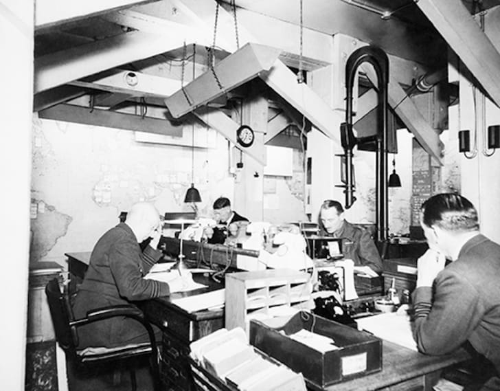 Map Room Officers at work in the Cabinet War Rooms, 1945.