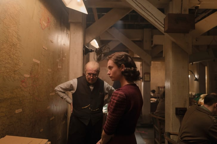 Oldman as Churchill, Lily James as Elizabeth Layton (Churchill's secretary) in the Map Room