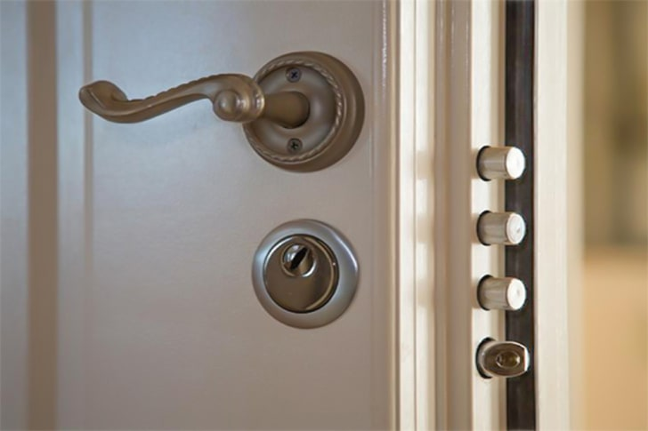 A secure door with several locks