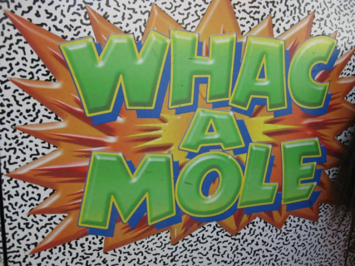 The cabinet art for the Whac-A-Mole arcade game