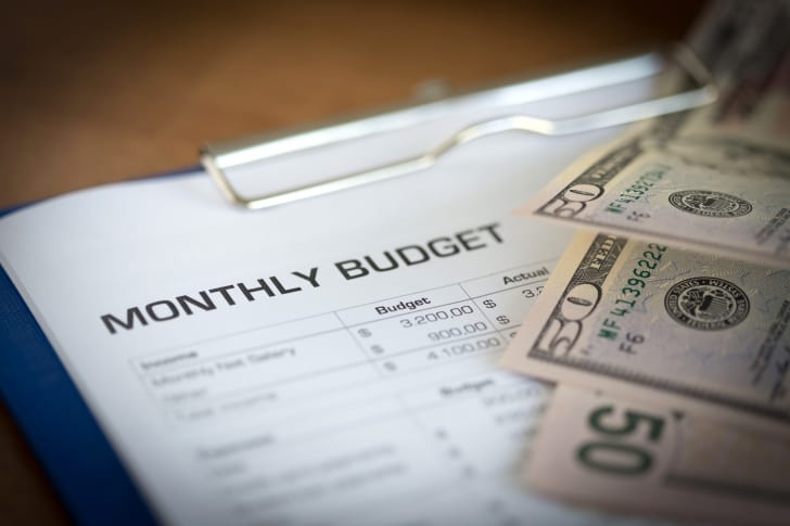 Budget and cash on table