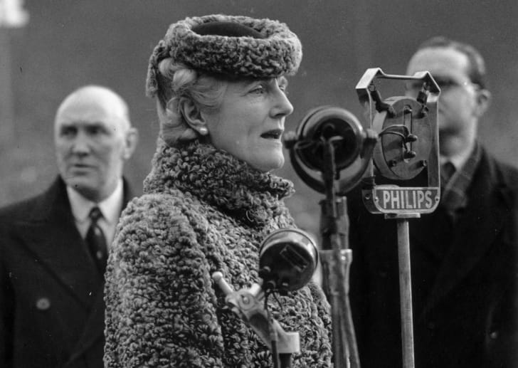 Clementine Churchill speaks at a microphone.