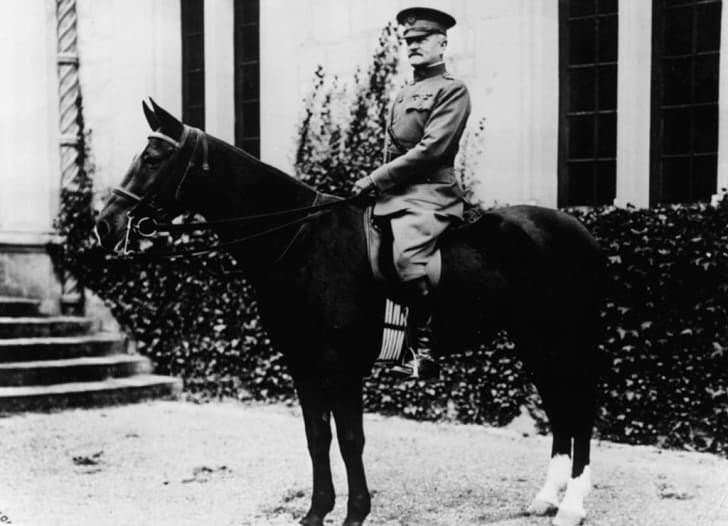 John J. Pershing in uniform sitting on a horse.