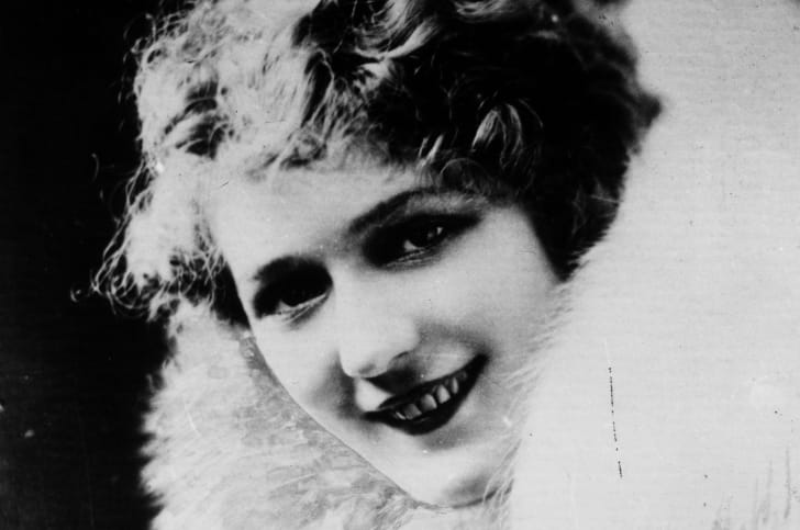 A close-up photo of silent film star Mary Pickford smiling.