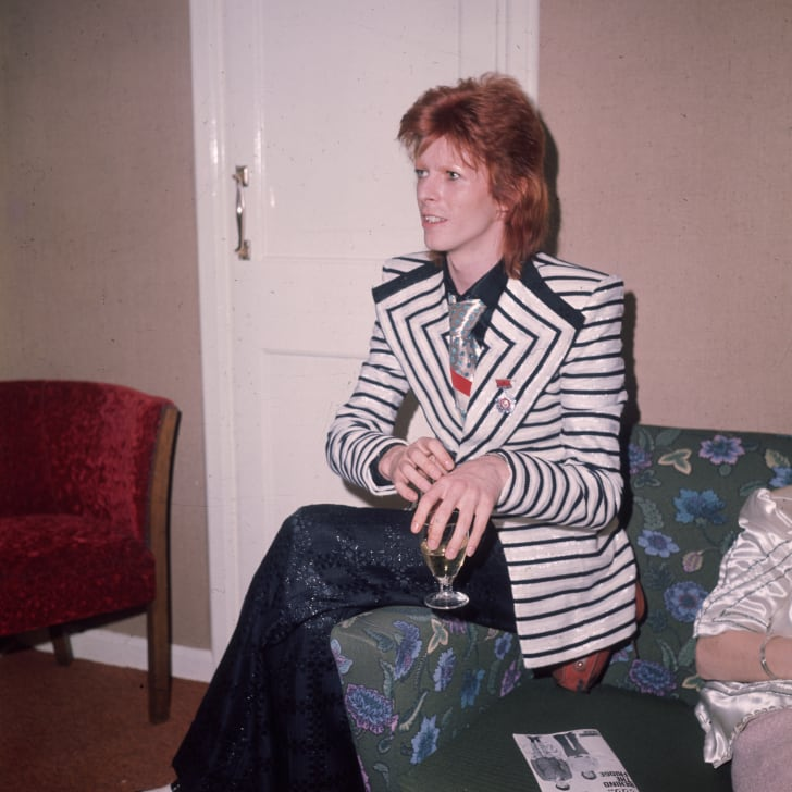 May 1973: In a black and white horizontally striped jacket with wide lapels glam rock star David Bowie