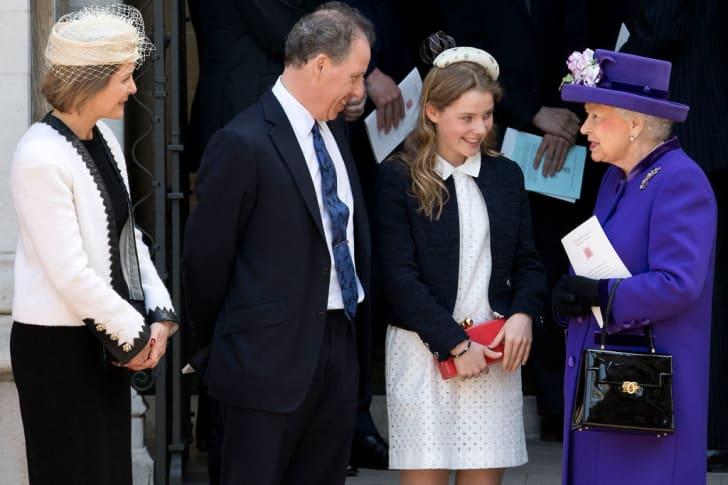 Britain's Queen Elizabeth II (R) speaks to Serena Armstrong-Jones, Countess of Snowdon (L), David Armstrong-Jones (2L), 2nd Earl of Snowdon, and Lady Margarita Armstrong-Jones (2R).