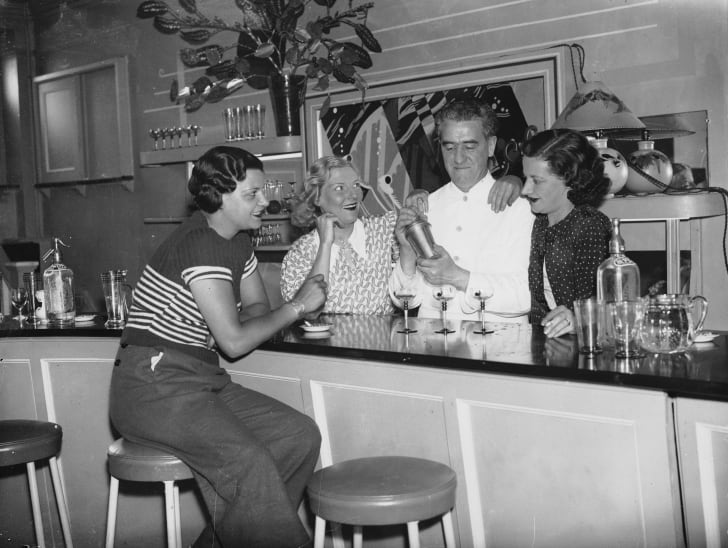 A barman at the St Mellons Club near Cardiff mixing cocktails for the Carlyle cousins, 1936