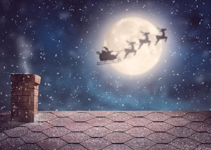 Santa and his reindeer flying