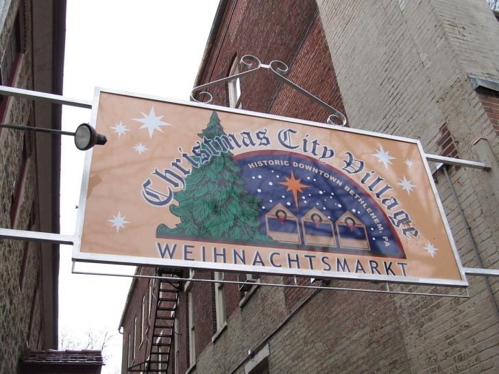 A sign reads 'Christmas City Village Weihnachtsmarkt.'