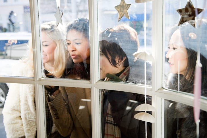 Shoppers look through the window of a store