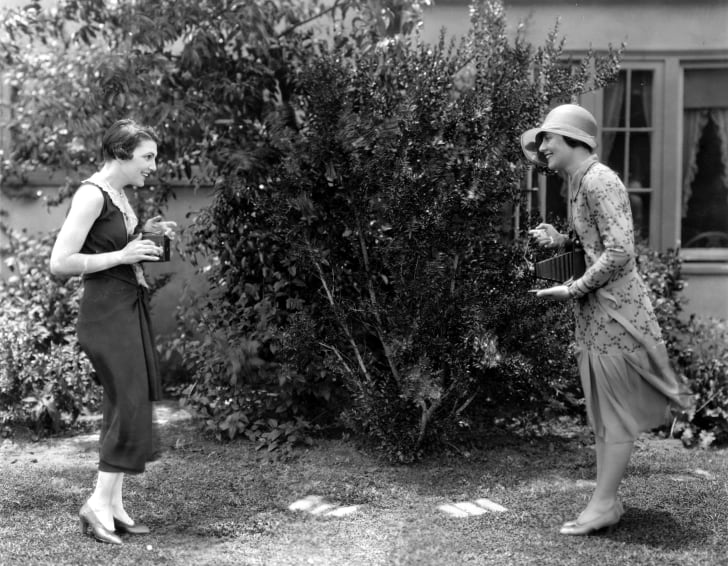 Two actresses taking pictures in 1925.