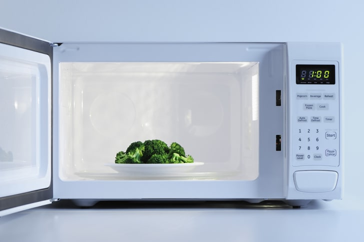 A bowl of broccoli in a microwave