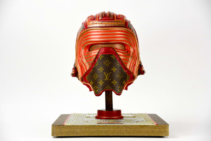 A Star Wars mask crafted from upcycled vintage Louis Vuitton handbags, created by artist Gabriel Dishaw.