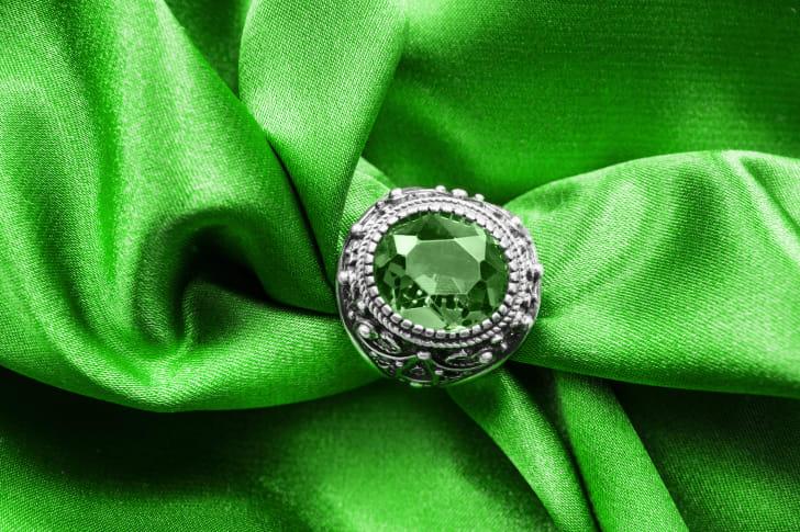 emerald ring on green satin