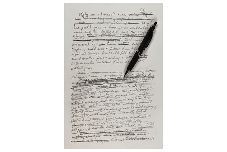 A page of the handwritten manuscript with a pen on it