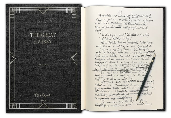 A handwritten manuscript of 'The Great Gatsby' open to a page
