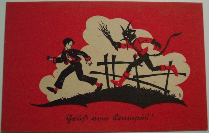 Postcard of Krampus chasing a child.
