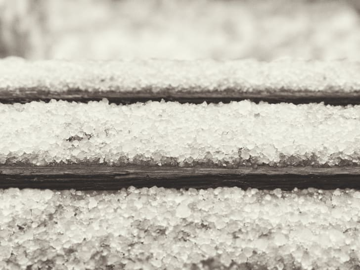 Snow and hail on wood.