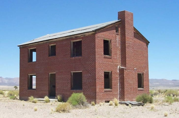 A building built to test a nuclear reaction in Survival Town, Nevada.