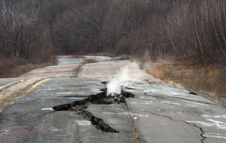 Smoke coming up from cracked concrete in Centralia, Pennsylvania.