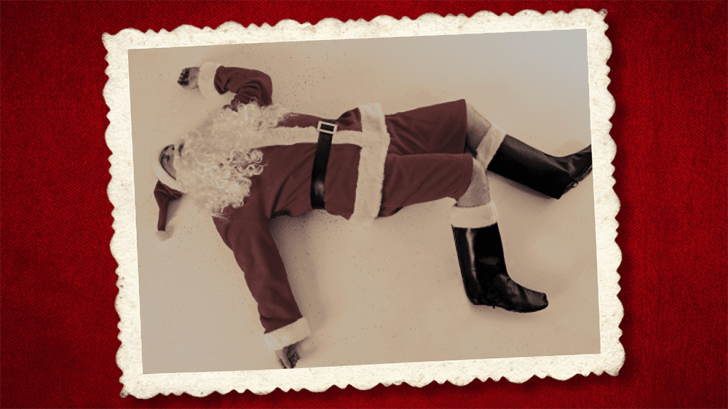 Santa lying prone on the floor