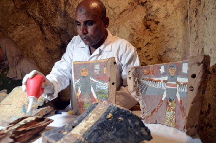 An Egyptian archaeological technician restores artifacts found at the newly discovered 'Kampp 161' tomb at Draa Abul Naga necropolis in Luxor, Egypt.