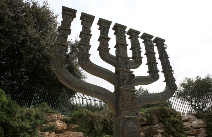 A stone menorah outside the knesset.