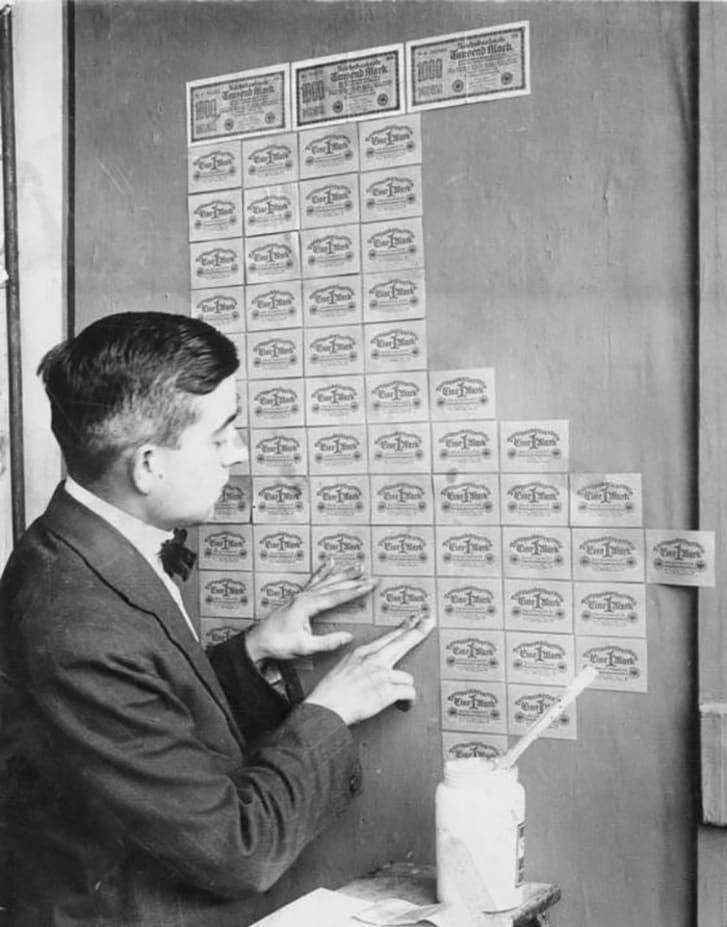 A man using money as wallpaper.
