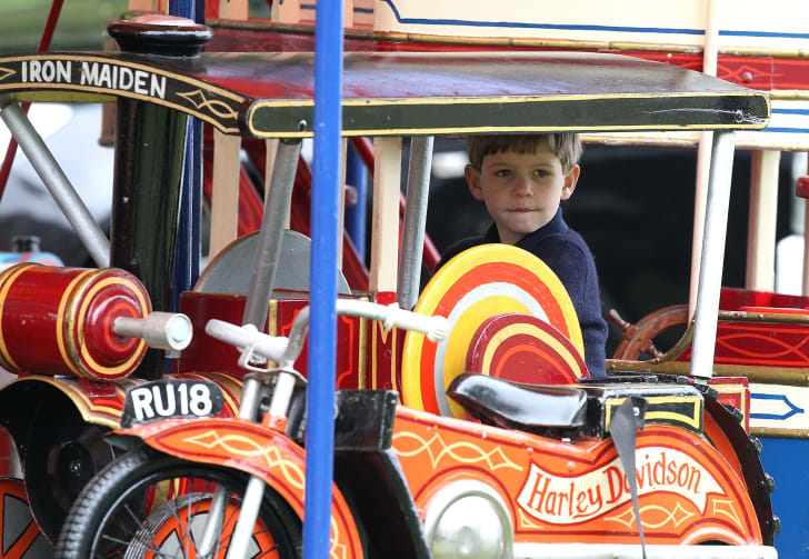 James, Viscount Severn, rides on the fun fair carousel on day 4 of the Royal Windsor Horse Show on May 11, 2013 in Windsor, England