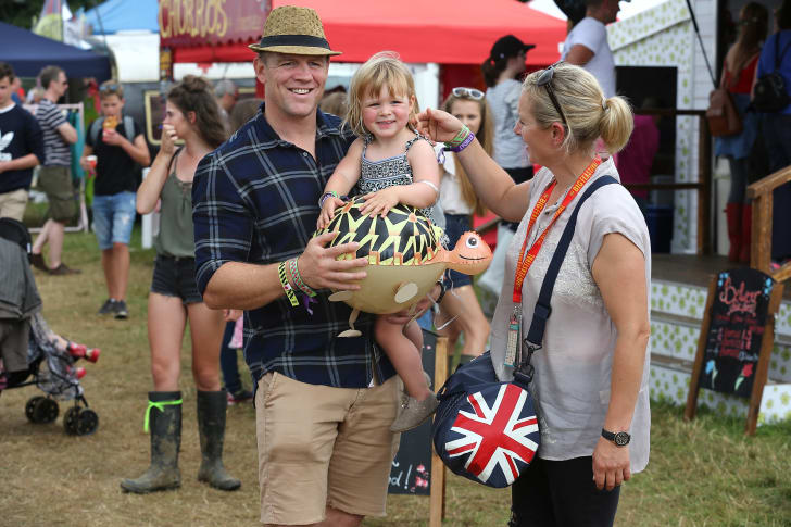 Mike Tindall, Zara Tindall and their daughter Mia Tindall pose for a photograph during day three of The Big Feastival at Alex James' Farm on August 28, 2016 in Kingham, Oxfordshire.
