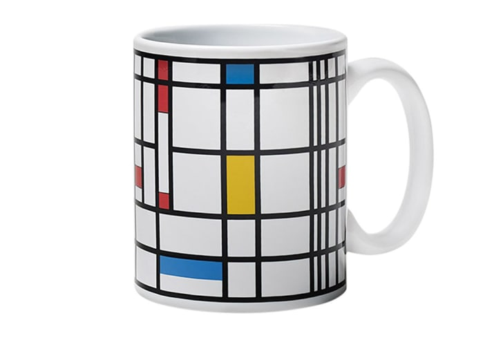 A mug features a Mondrian-inspired design.