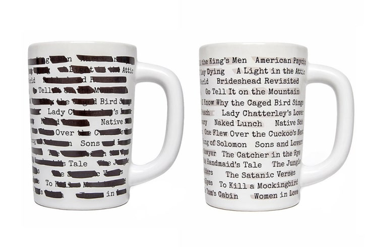 Two mugs feature the titles of books that have been banned, one with the titles blacked out.