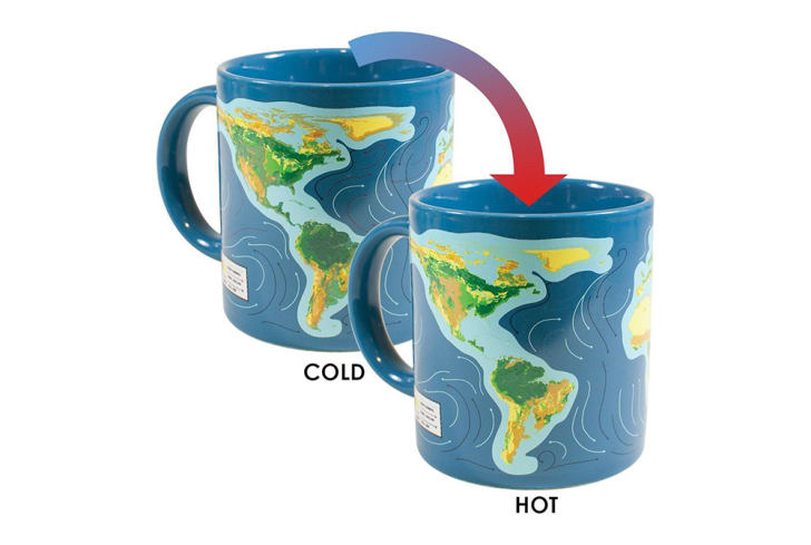 Two mugs depict a world map and rising sea levels.