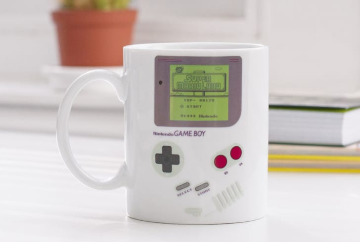 A mug decorated to look like a Game Boy