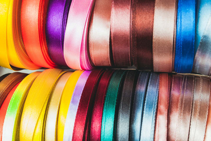A close up of spools of ribbon.