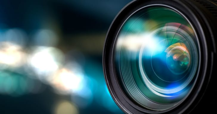 A camera lens is shown reflecting light