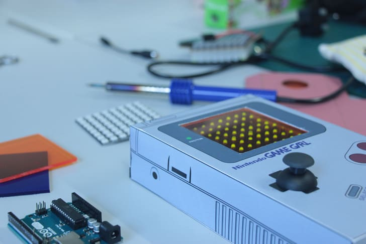 A pixel kit is housed in a cardboard box that looks like a Game Boy.