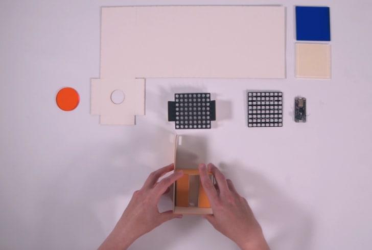 A screenshot shows a user assembling a Bixel kit on video.