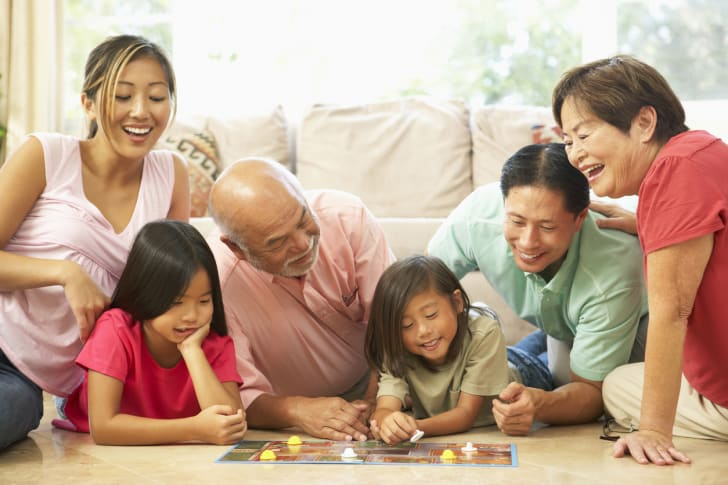 Photo of a family playing a board game