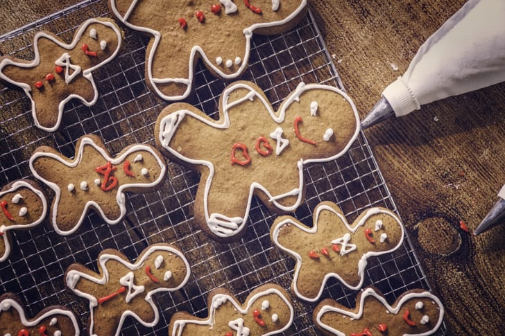 A photo of gingerbread cookies being iced