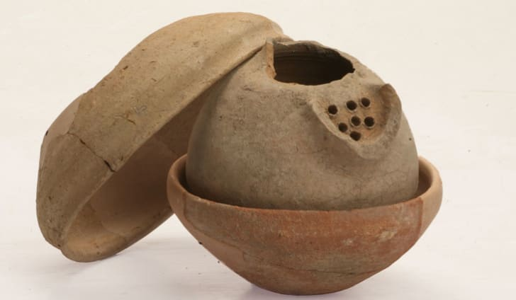 A bowl concealed an Iron Age jug with its neck removed, to accommodate a hoard of precious jewelry.