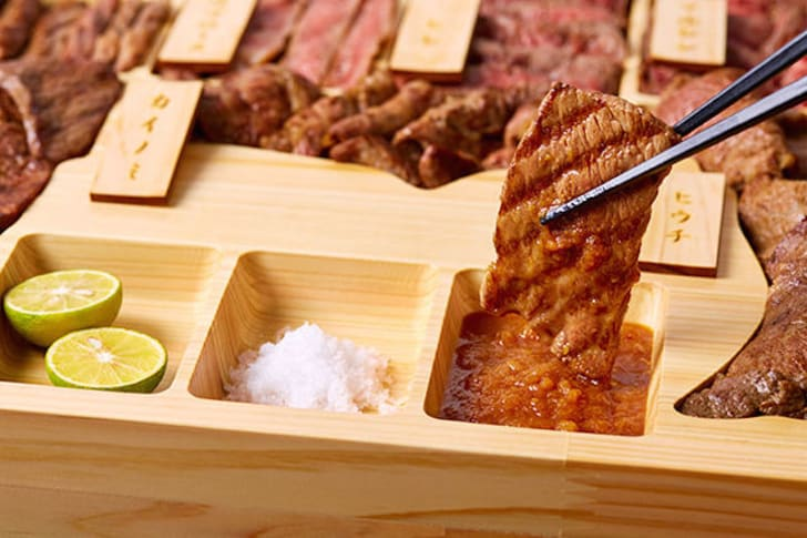 Dipping beef in a bento box.