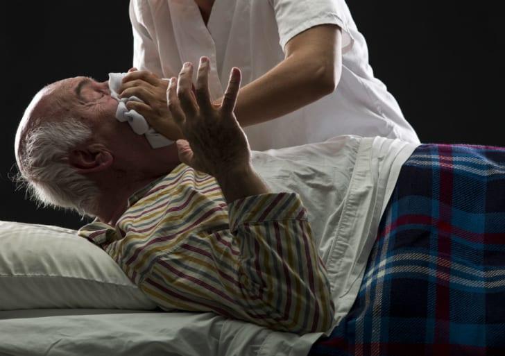 A man forces a patient to inhale chloroform
