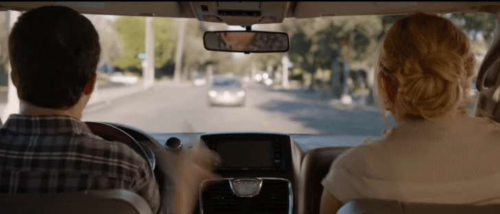 A screen capture of a film featuring two removed headrests in a vehicle