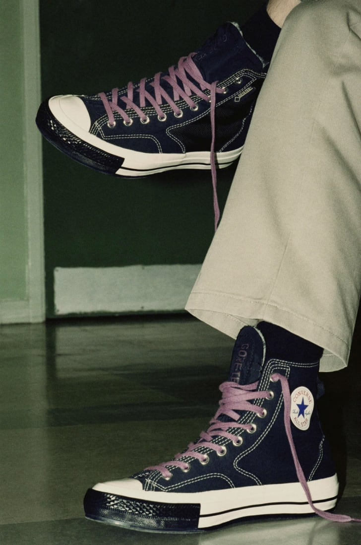 A model sports a pair of Converse Hikers in black